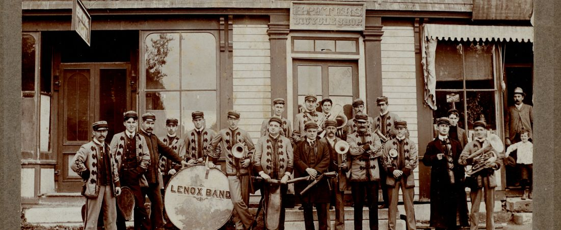 Lenox Band: bandmembers in front of H. Peters Bicycle Shop