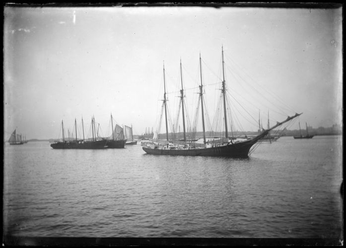 Four-masted ships in a harbor