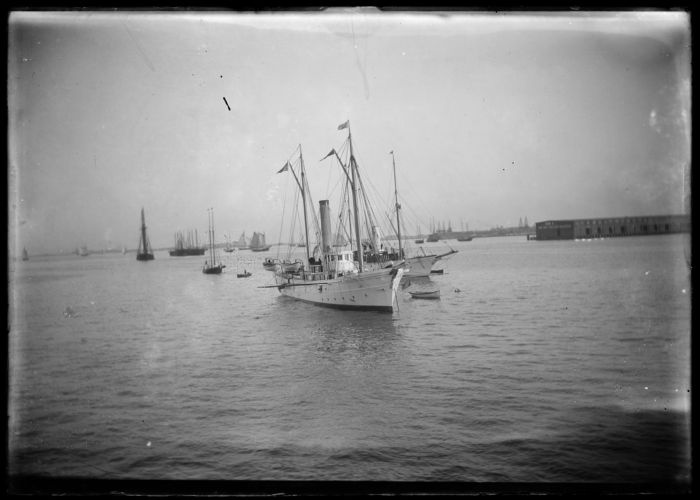 Sailing ships in harbor