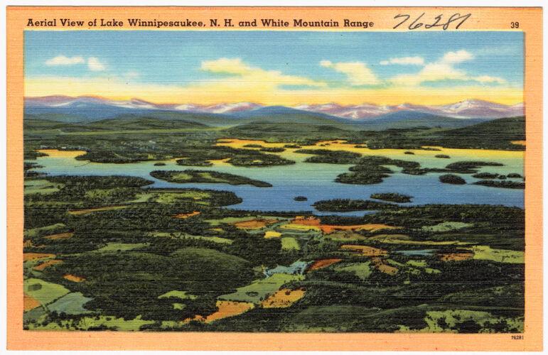 Aerial view of Lake Winnipesaukee, N.H. and White Mountain Range