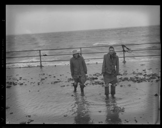 Two girls enjoying big surf, Beachmont, Revere