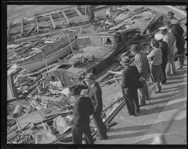 Boats and debris on beach, Hurricane of 38