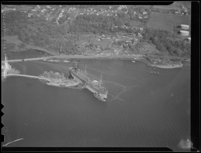 Aerial photo of freighter aground on small island, Hurricane of 38