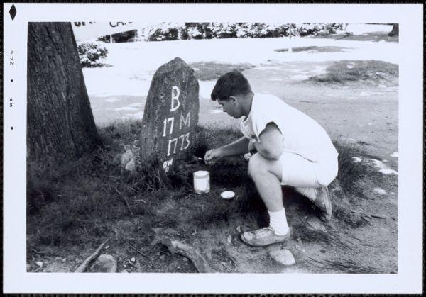 Repainting letters on milestone, Pleasant St., Canton