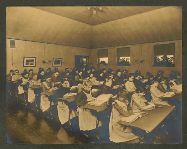 Girls in their reading room (room opens out of library), Overbrook School for the Blind, Philadelphia