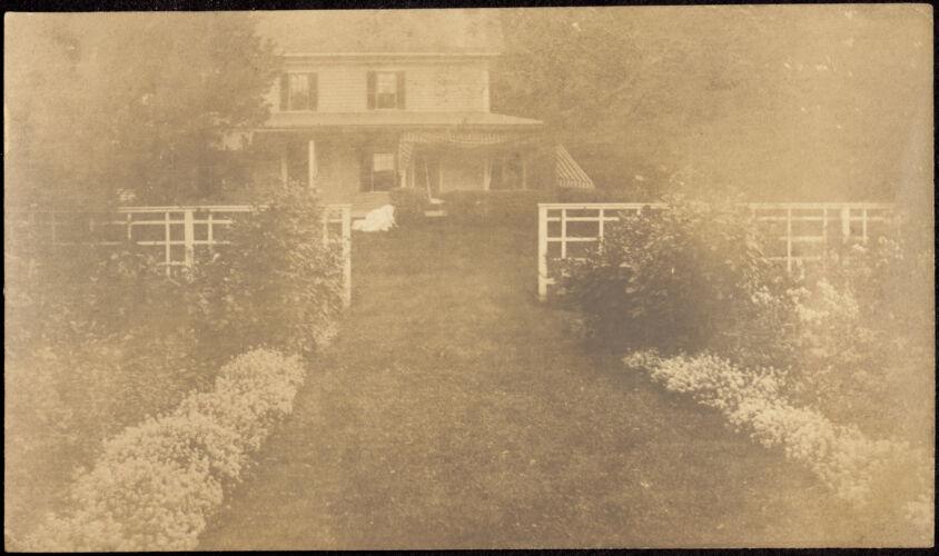 Ashdale Farm. House, fence and perennial garden