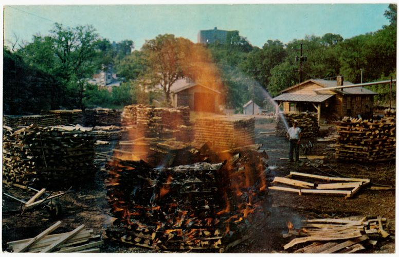 Making charcoal at Jack Daniel's, Jack Daniel Distillery, Lynchburg (pop. 361), Tennessee