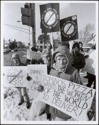 Feminists Against Crusading Terrorists (F.A.C.T.) protest the building of Domino's Pizza at Broadway & Prospect Cambridge