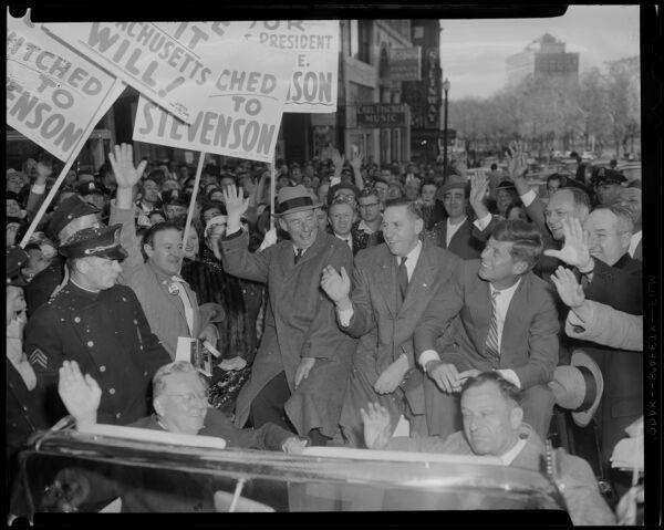 Men in convertible, including John F. Kennedy
