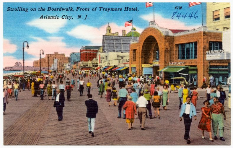 Strolling on the boardwalk, front of Traymore Hotel, Atlantic City, N. J.