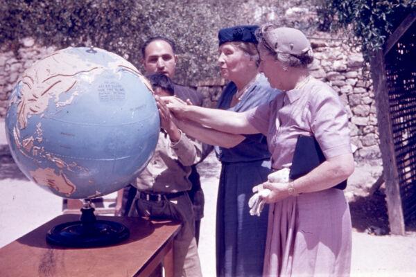 Helen Keller and Polly Thomson Exploring Tactile Globe