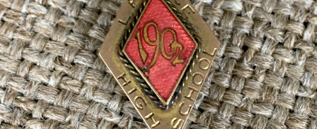 """Diamond-shaped pin inscribed """"Lawrence High School 1902"""""""