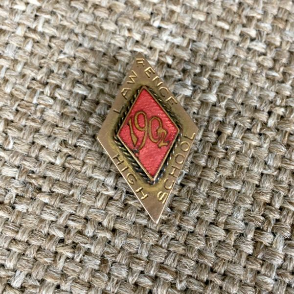 "Diamond-shaped pin inscribed ""Lawrence High School 1902"""
