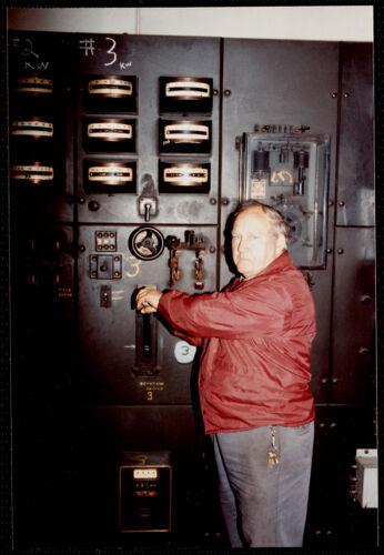Lower Pacific Mills. Jim McGregor, maintenance man (36 yrs employed) at main power switch to #3 generator