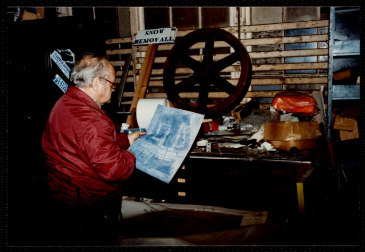Lower Pacific Mills. Maintenance room. Jim McGregor at his storage file for blueprints, graphics & drawings