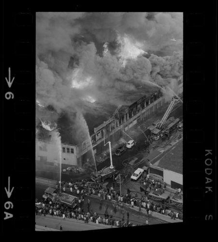 Aerial view of firemen battling fire on Clinton Street, Boston